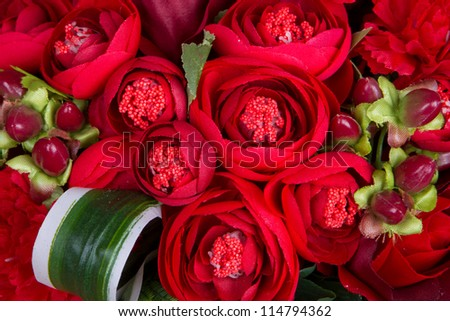 Red roses arranged in groups on sackcloth - stock photo
