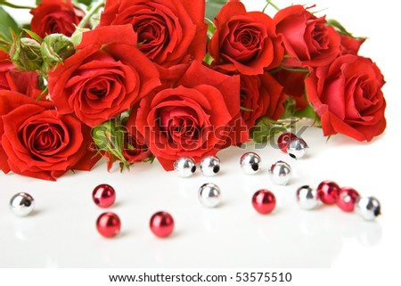 Red roses bouquet and beads on white background - stock photo