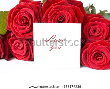 Red roses bunch with greeting card isolated on white background