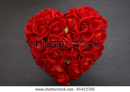 Red roses in a heart shape - stock photo