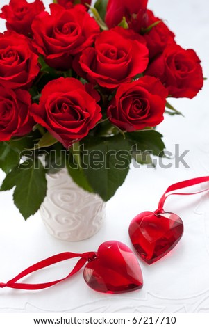 red roses in vase and hearts for Valentine's Day - stock photo