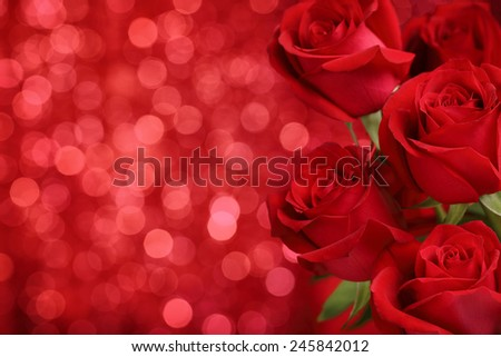 Red roses on bokeh background,Closeup. - stock photo