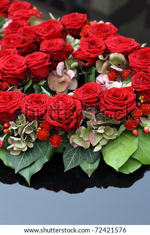 red roses on bridal car - stock photo