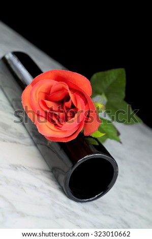 Red roses with black vase on a marble table, still life, art, decoration - stock photo
