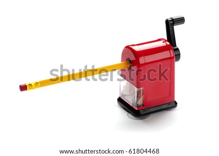 red rotary pencil sharpener with yellow pencil isolated on white background