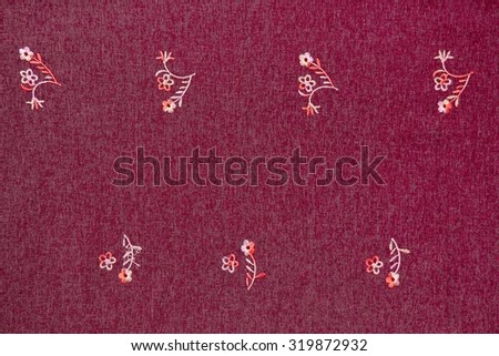 Red rough cloth with embroidery flower patterns texture. - stock photo