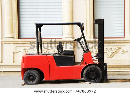 Red Rough Terrain Forklift in the yard