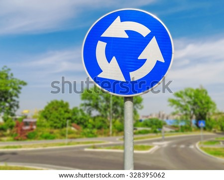 Red roundabout crossroad road traffic sign  - stock photo