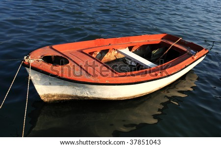 Red rowing boat on water