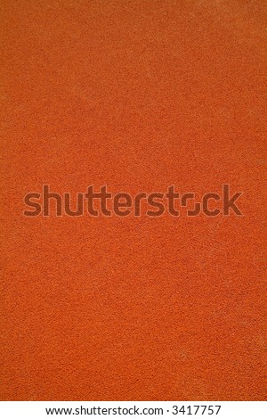 red rubber floor of a basketball court - stock photo