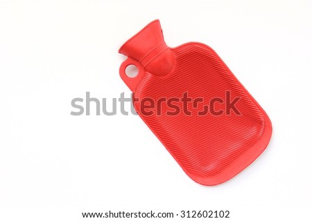 Red rubber hot water bag/bottle on white background. - stock photo