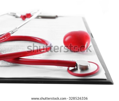red rubber stethoscope with plastic heart and medical history isolated on white - stock photo