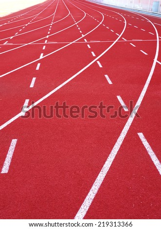 Red running track and sports stadium - stock photo