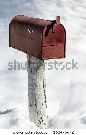 Red Rural Mailbox in the Snow Vertical  - stock photo
