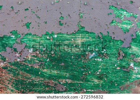 red rusted on the metal wall. green paint. background and Texture for your design. - stock photo