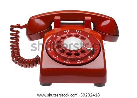 Red  60s rotary dial phone isolated with clipping path - stock photo