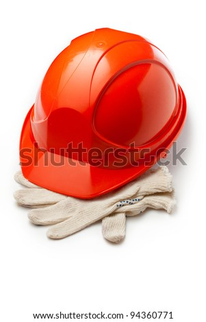 Red safety helmet with gloves - stock photo