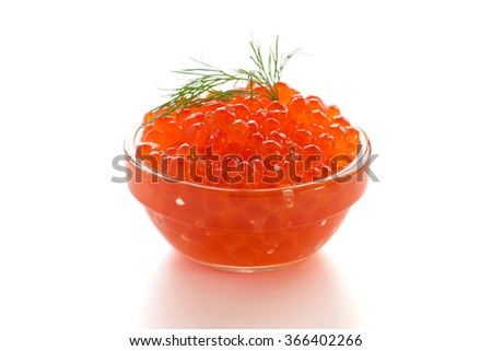 Red salmon caviar in a bowl on a white background - stock photo