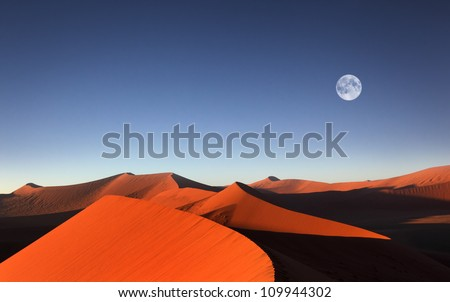 Red sand dune with full moon, Sossusvlei, Namibia - stock photo