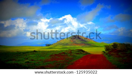 Red Sand Road and Mountain in Hawaii - stock photo