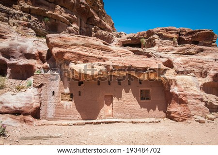 Red sandstone rocks in Petra (Rose City), Jordan. The city of Petra was lost for over 1000 years. Now one of the Seven Wonders of the Word - stock photo