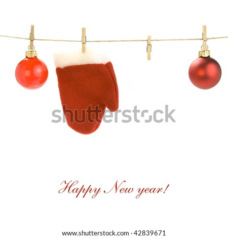 Red santa claus glove and Christmas balls on clothes line (with sample text) - stock photo