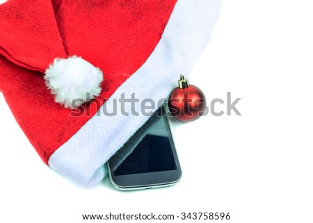 Red Santa Claus hat and smartphone on white background - stock photo