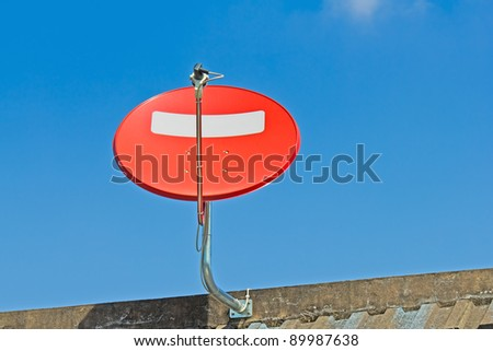 Red satellite dish installing on the roof - stock photo