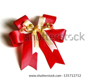 Red satin gift bow. Ribbon. on white background