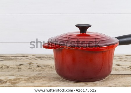 Red saucepan - stock photo