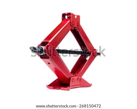 Red scissor jack shot on white - stock photo
