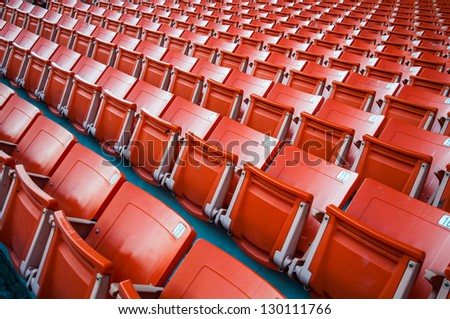 Red seat in arena - stock photo