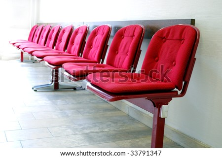 red seats in a row in a waiting room - stock photo