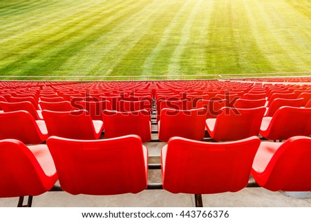 Red seats in an open stadium