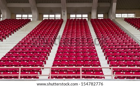 Red seats in stadium. - stock photo