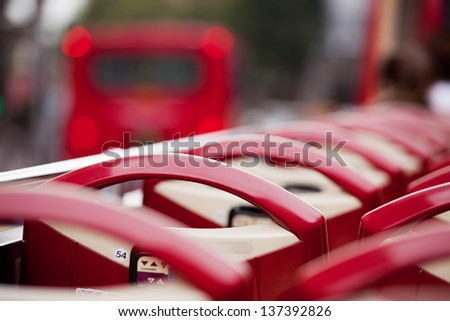 Red seats of open top sightseeing bus - stock photo