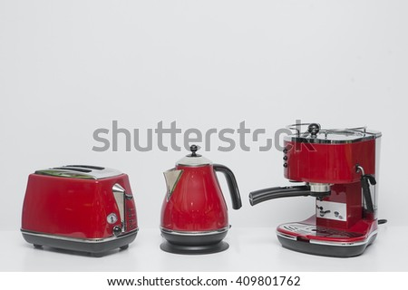 Red set of kettle, toaster and coffee make - stock photo