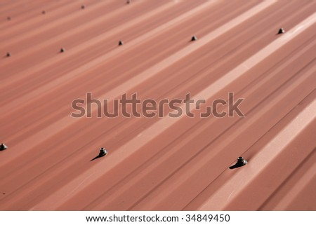 red sheet metal roof detail with selective focus - stock photo