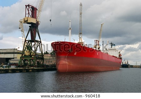 Red ship at docks