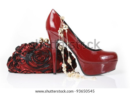 Red shoe, clutch bag and gold necklace - stock photo