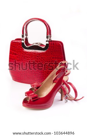 Red shoes, bag and belt isolated on white background