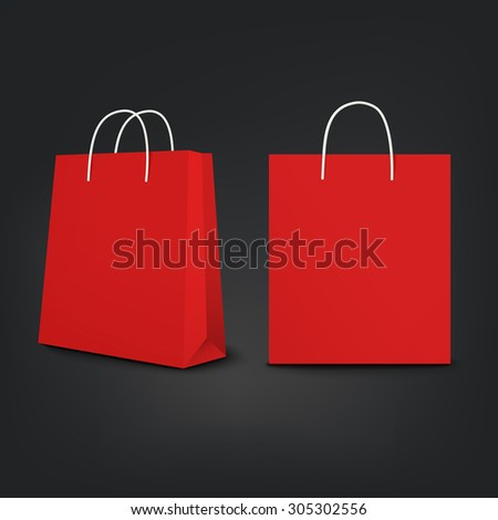 red shopping bags set isolated on black background - stock photo