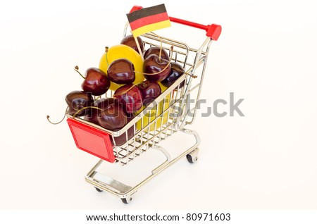 red shopping cart with plum and cherry
