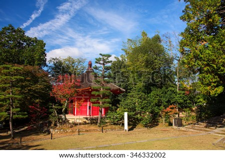 Red shrine against blue sky of Tofukuji temple in Kyoto, Japan