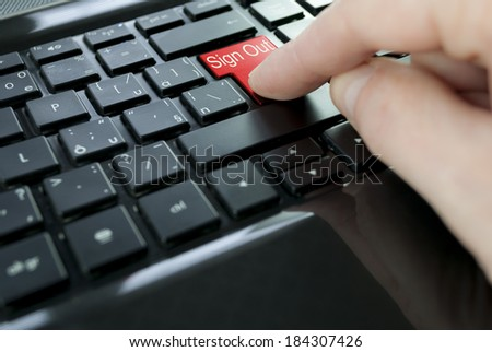 red sign out button or key on black keyboard
