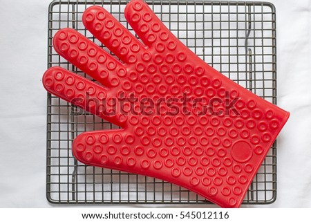 Red silicone glove on cooling tray