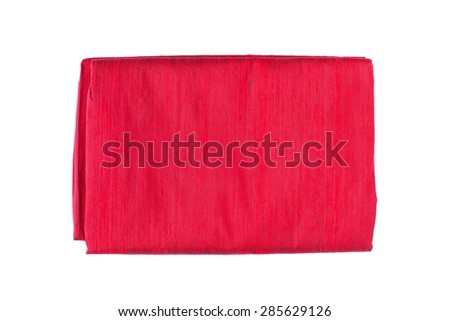 Red silk fabric folded isolated on white background - stock photo