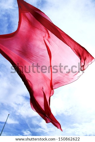 red silk in the sunlight - stock photo