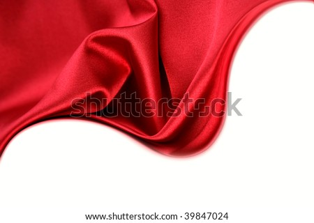 Red silk on white background. Copy space - stock photo