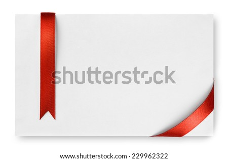 Red silk ribbon on empty paper card - stock photo